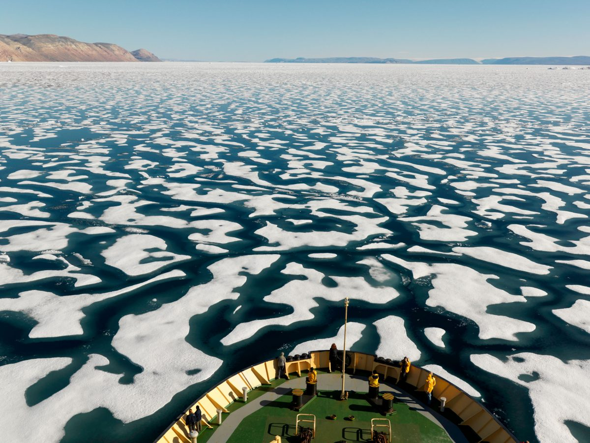Broken one year ice off the coast of Ellesmere Island, seen from prow of boat, Nunavut, Canada