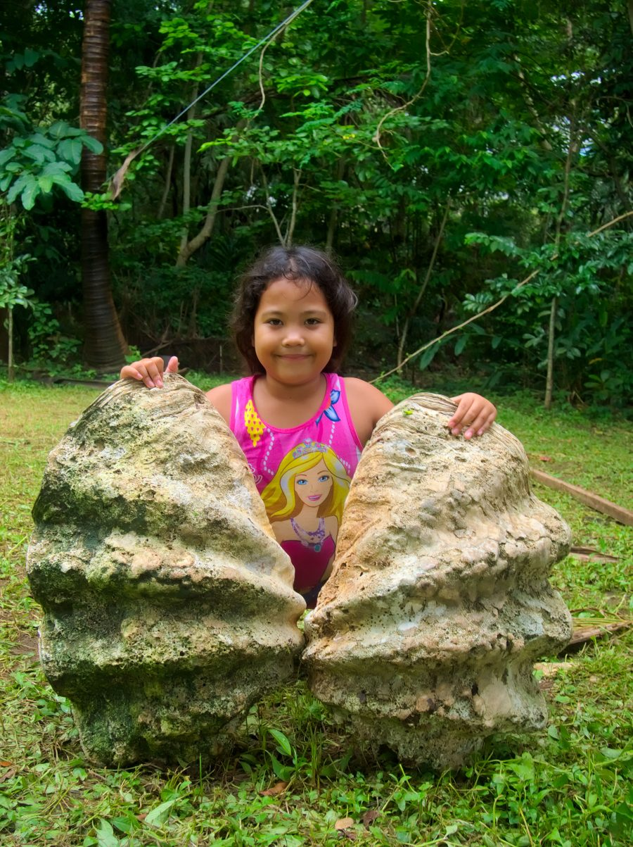 girl and giant clam shell