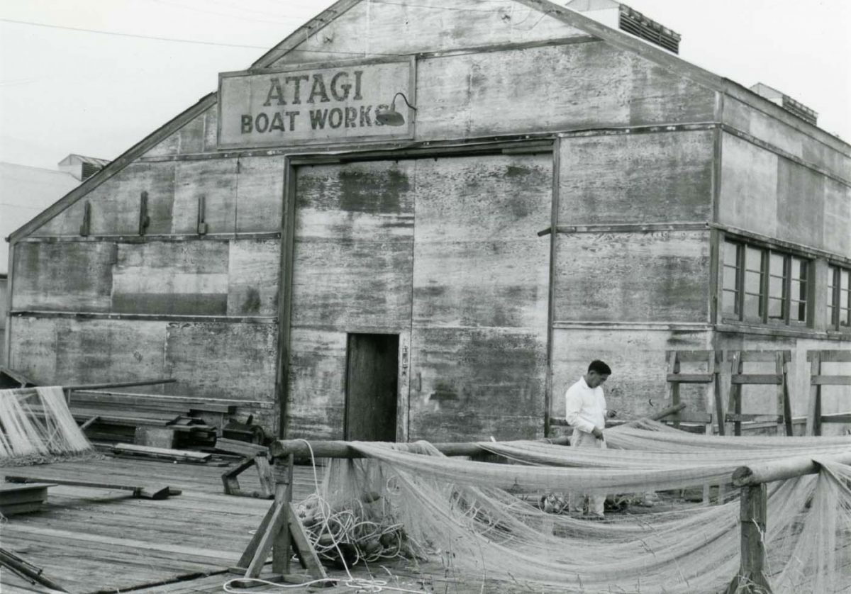 Satoshi mending fishing nets in 1966. Photo courtesy of the City of Richmond Archives