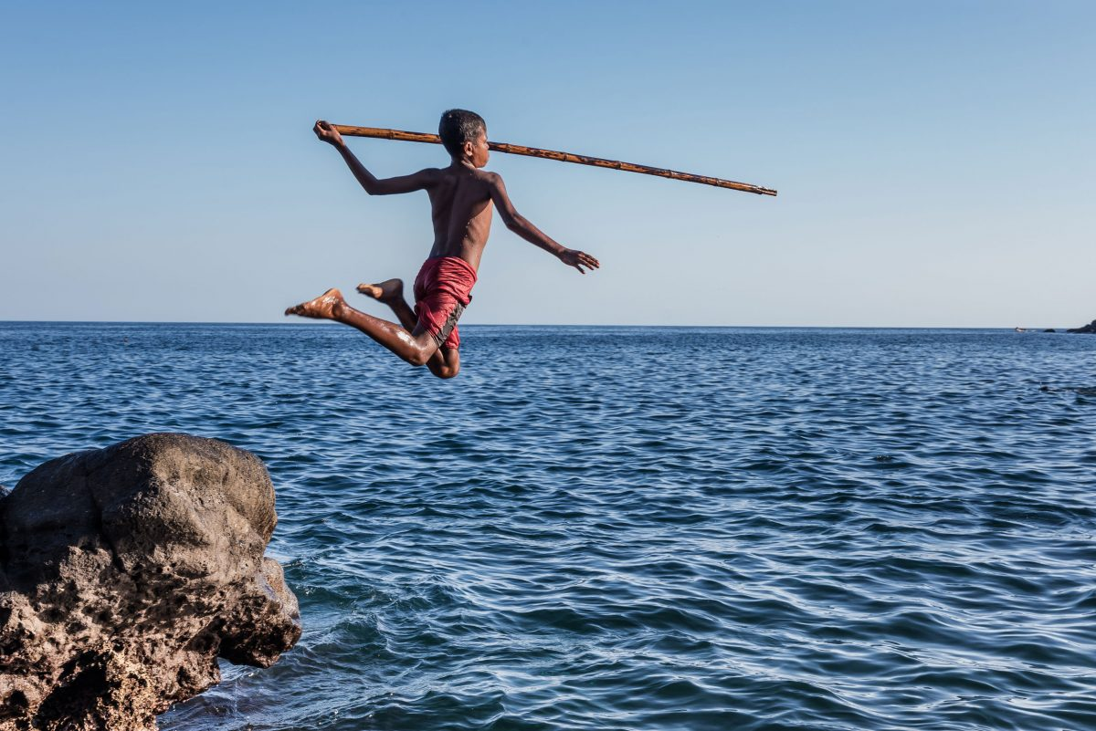 a 12-year-old boy practices for whale hunting