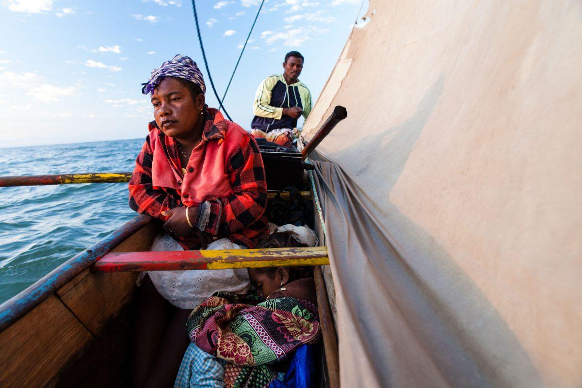semi-nomadic fishers in traditional canoe, Madagascar
