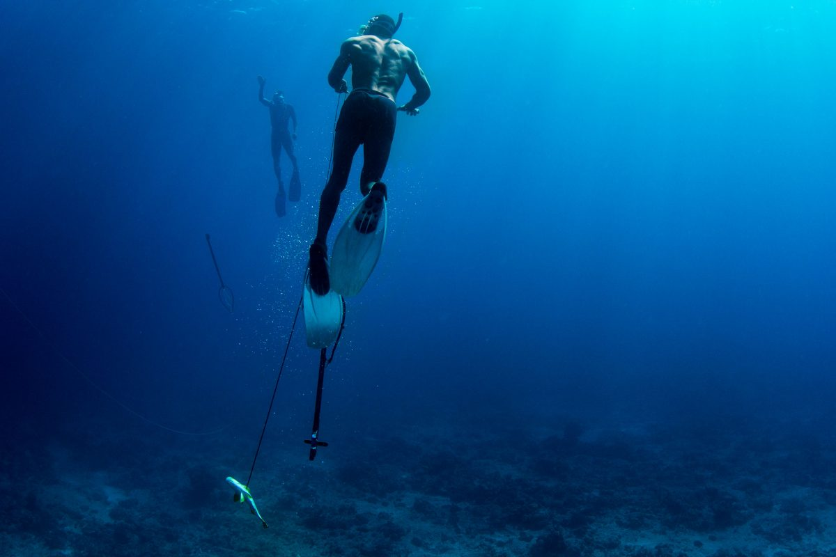 Two Vezo men spearfishing on a reef in the Mozambique Channel west of the Barren Isles.