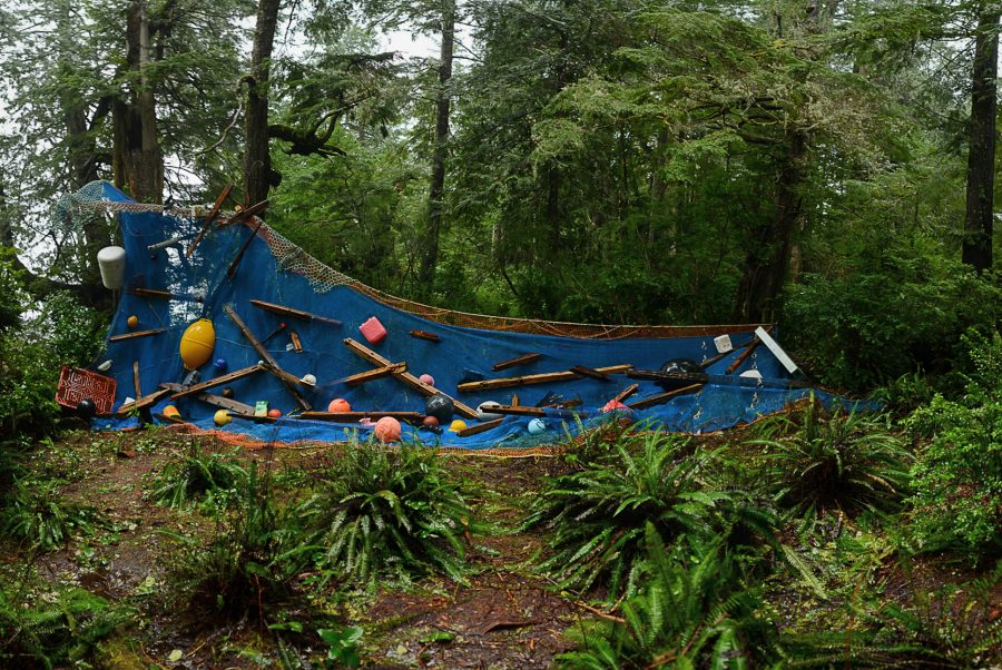 <em>Swept Away</em>, an installation at the Tofino Botanical Gardens, was assembled with fishing net and tsunami debris. Photo by Chris Pouget
