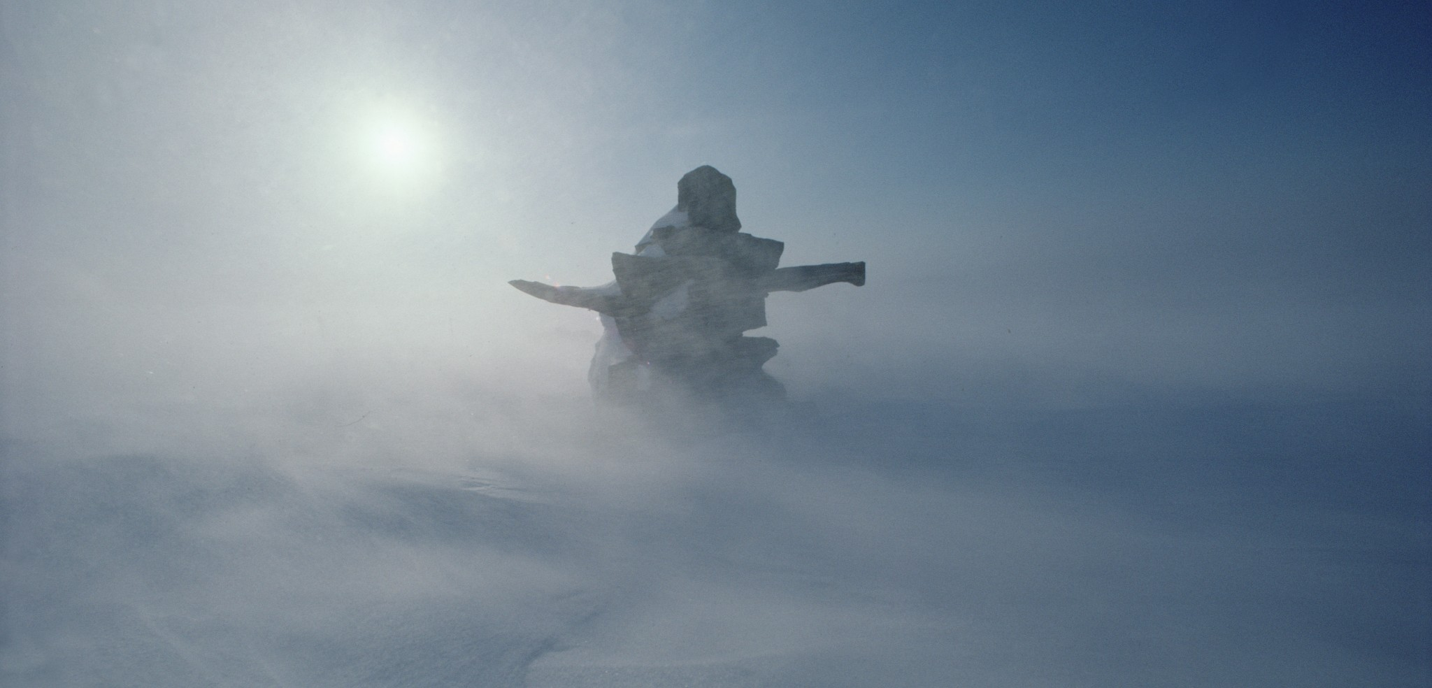 An Inuitdirection marker stands out amidst the blowing snow on Ellesmere Island.Even among the Inuit, the island'snorthern shoreline is largely devoid ofhuman life. Photo byJim Brandenburg/Minden Pictures/Corbis