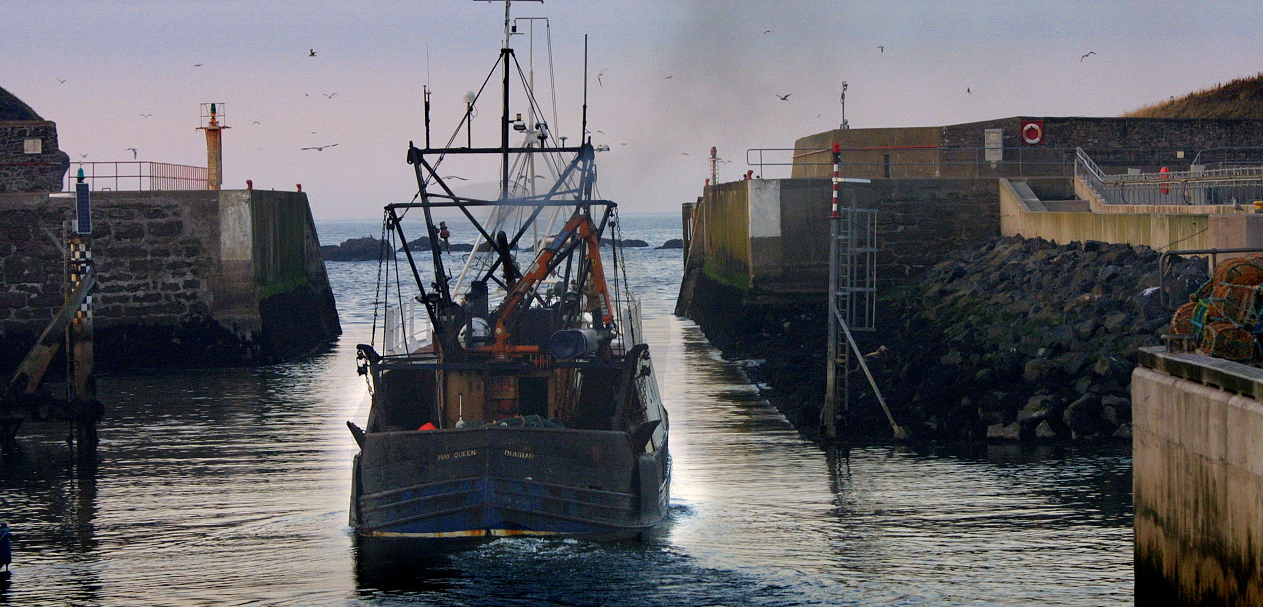 A fishing boat leaves from Eyemouth, Scotland, on October 31, 2002. Photo by Colin McPherson/Corbis