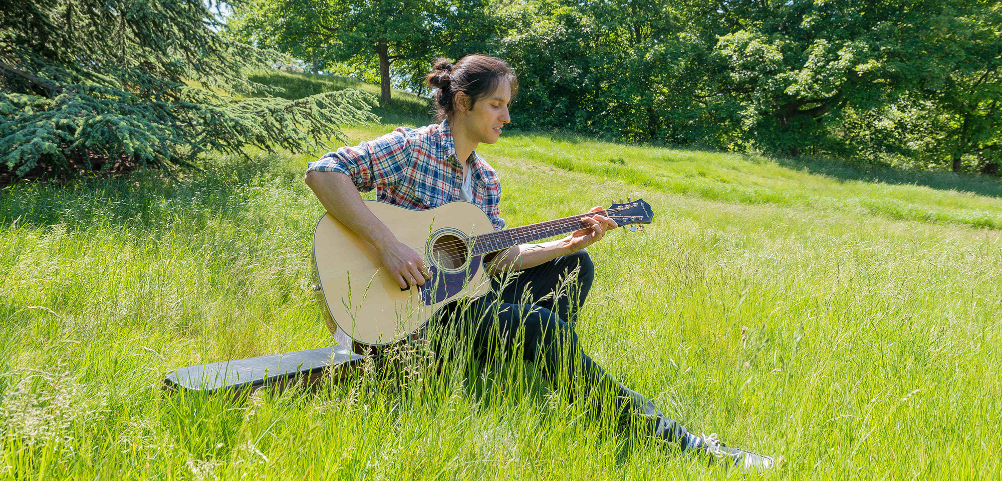A guitarist enjoys the summer sun in London's Greenwich Park. Photo by Velar Grant/ZUMA Press/Corbis