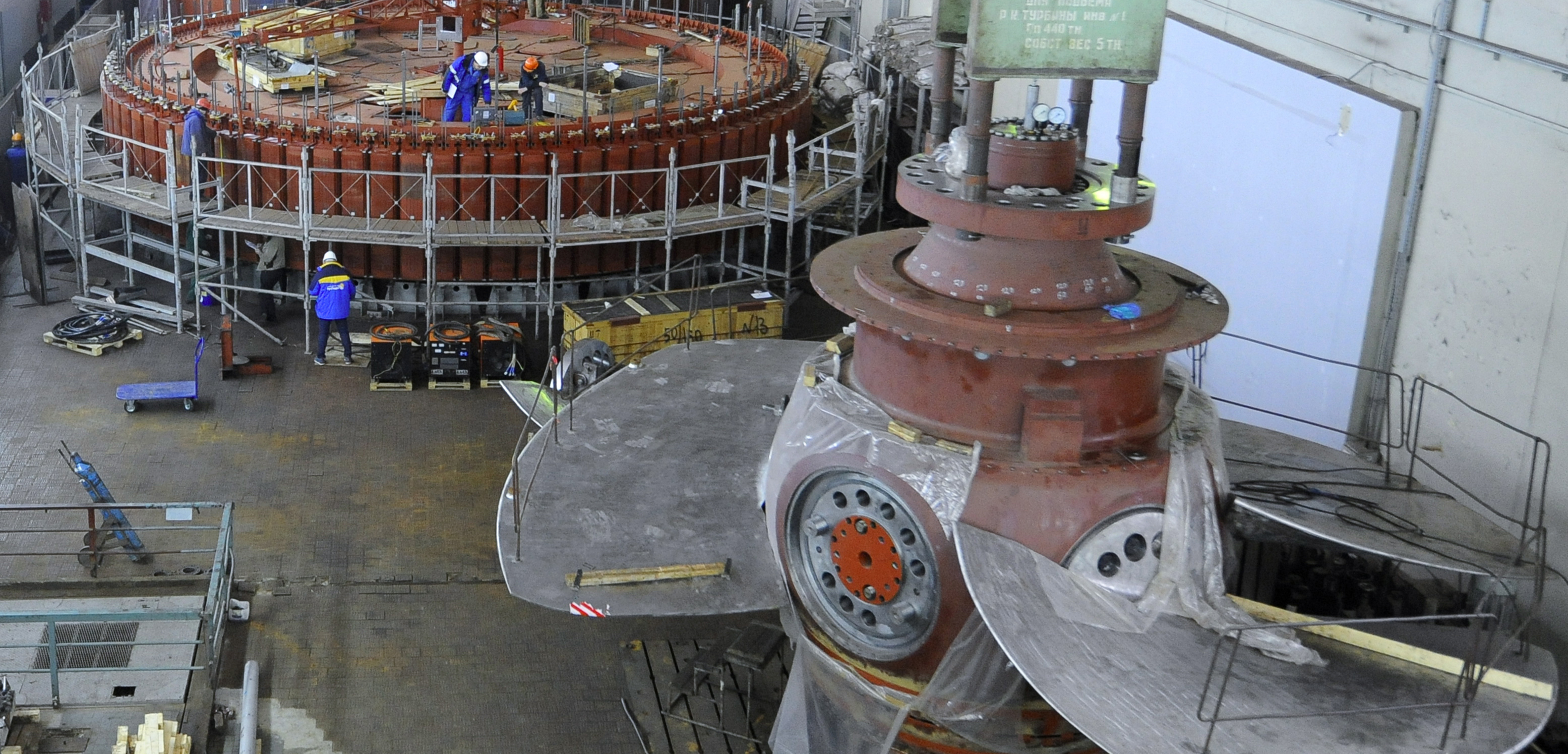 Workers look down at the massive blades of the turbine at the Volga Hydroelectric Power Station in Russia. Photo byDmitry Rogulin/ITAR-TASS Photo/Corbis