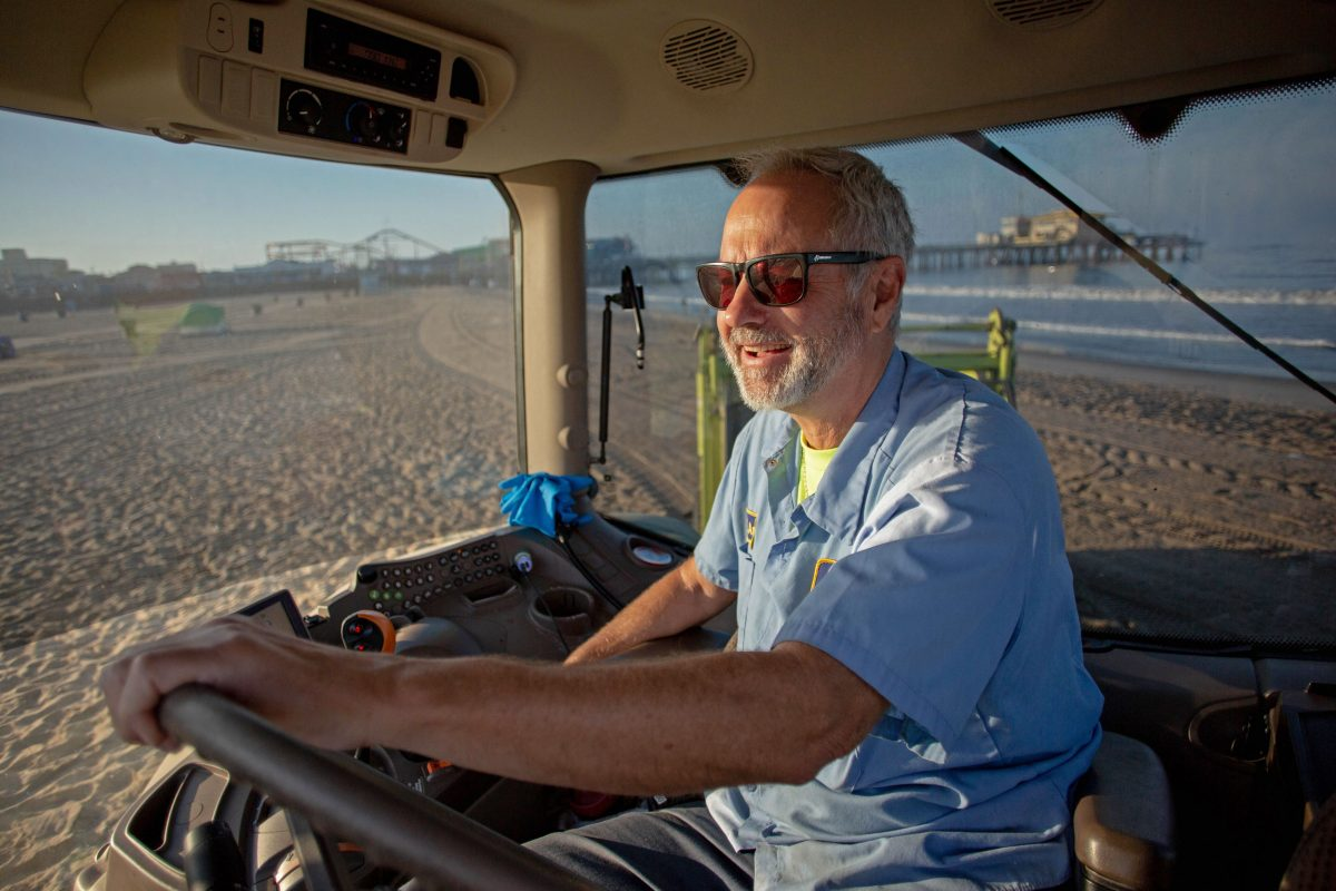 Gavin Andrus in the cab of his tractor grooming Santa Monica Beach