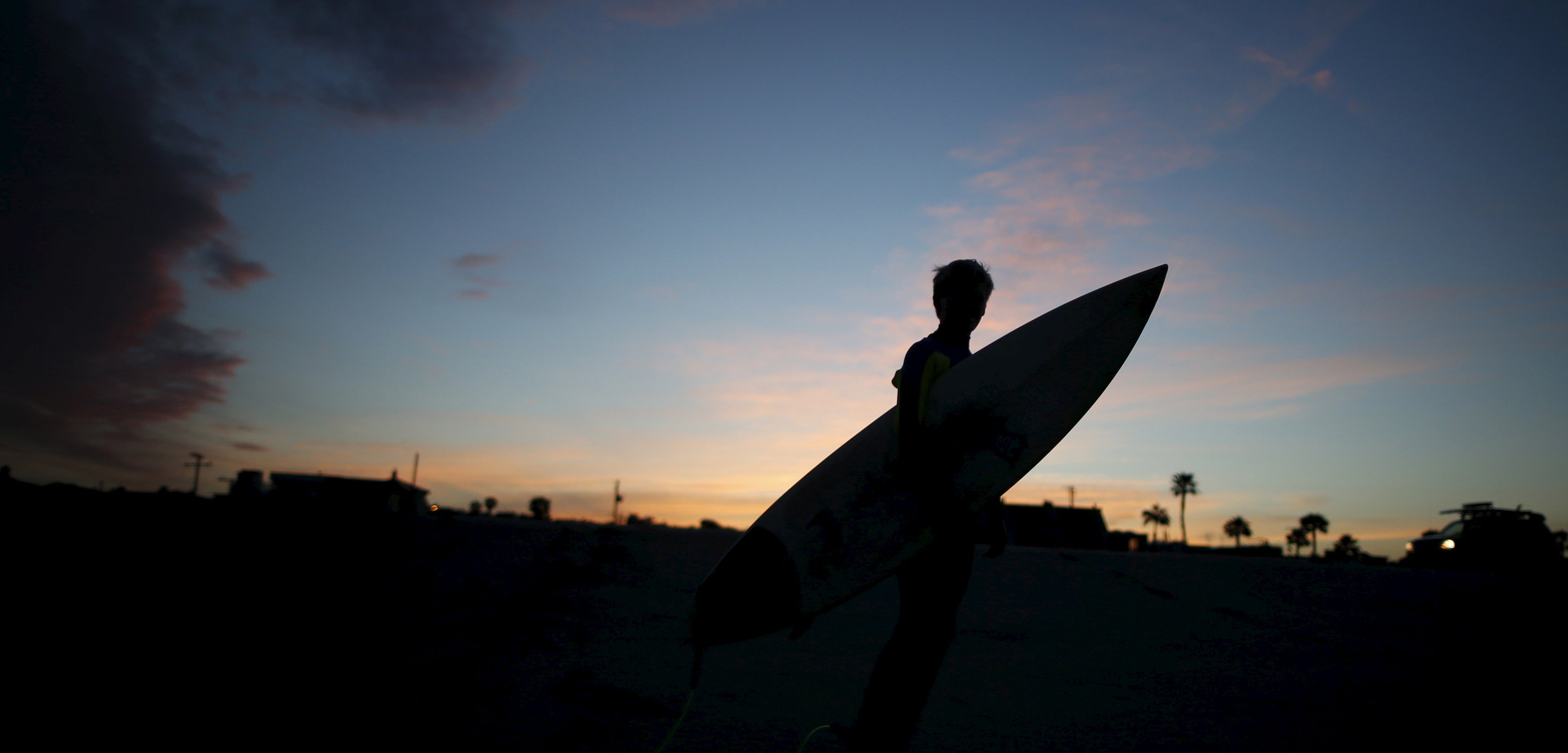 A 13-year-old surfer in California. Photo by Lucy Nicholson/Reuters/Corbis