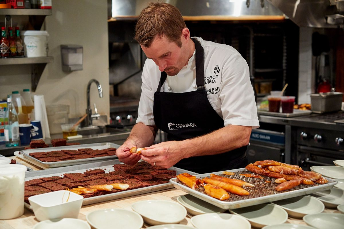 Chef Ned Bell carefully places fillets of farmed sablefish atop seaweed-laced brownies