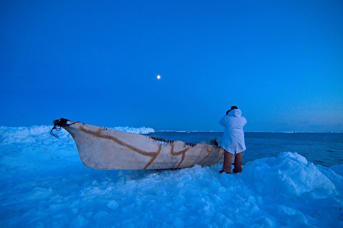 A whaler waits for the bowhead whales from shore in Utqiaġvik, Alaska, during whaling season in the Chukchi Sea. Photo by Steven J. Kazlowski/Alamy Stock Photo