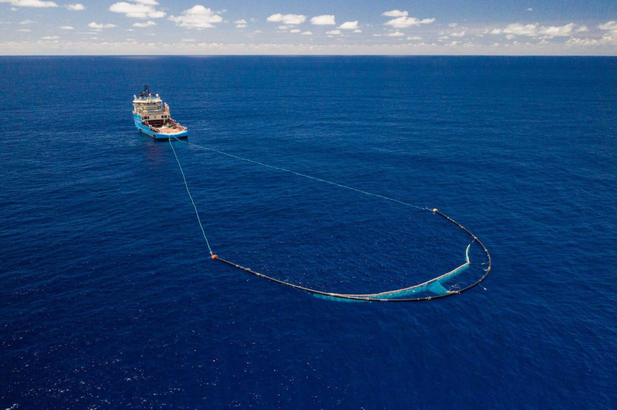 The Ocean Cleanup ship with boom