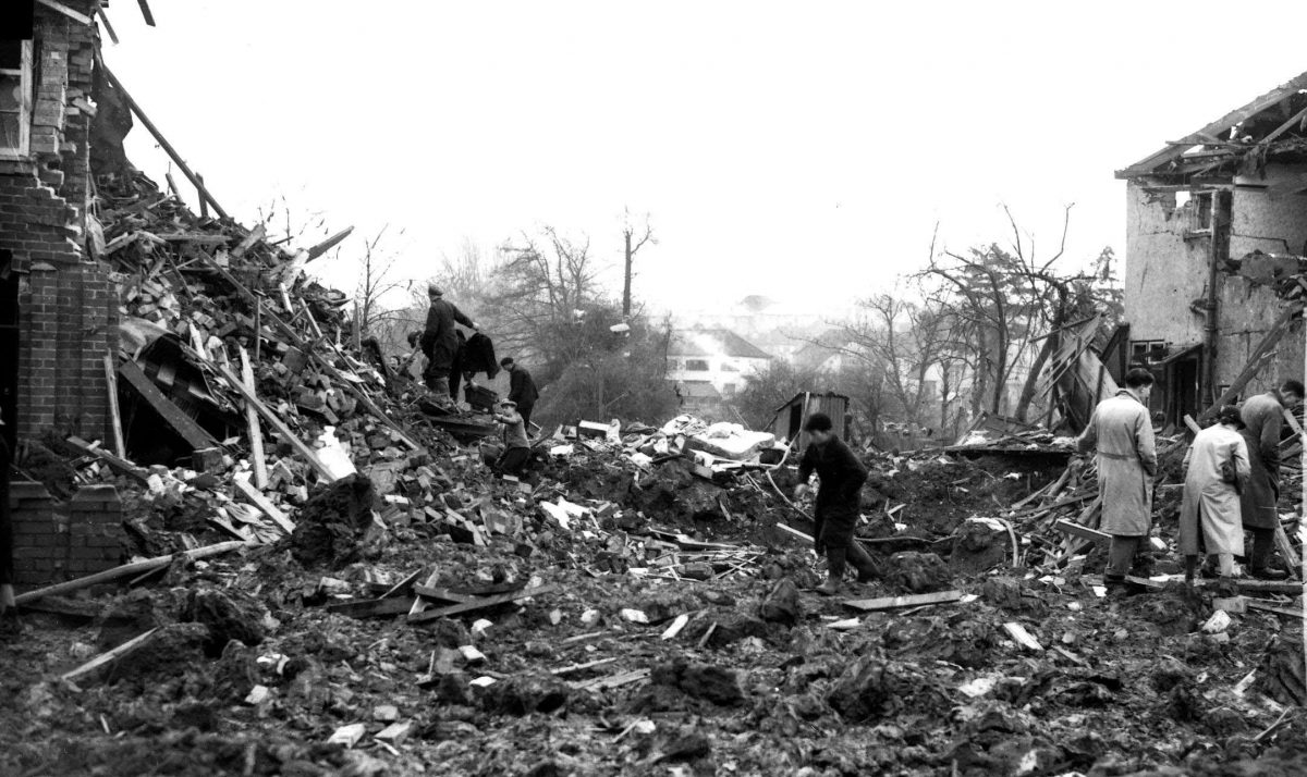 Air Raid Damage Bristol Civilians searching through rubble of their bomb damaged houses after an air raid on Bristol