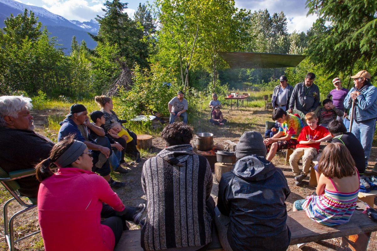 A group from the Wuikinuxv and Heiltsuk First Nations spends time in the backcountry on the British Columbia coast sharing stories and experiences
