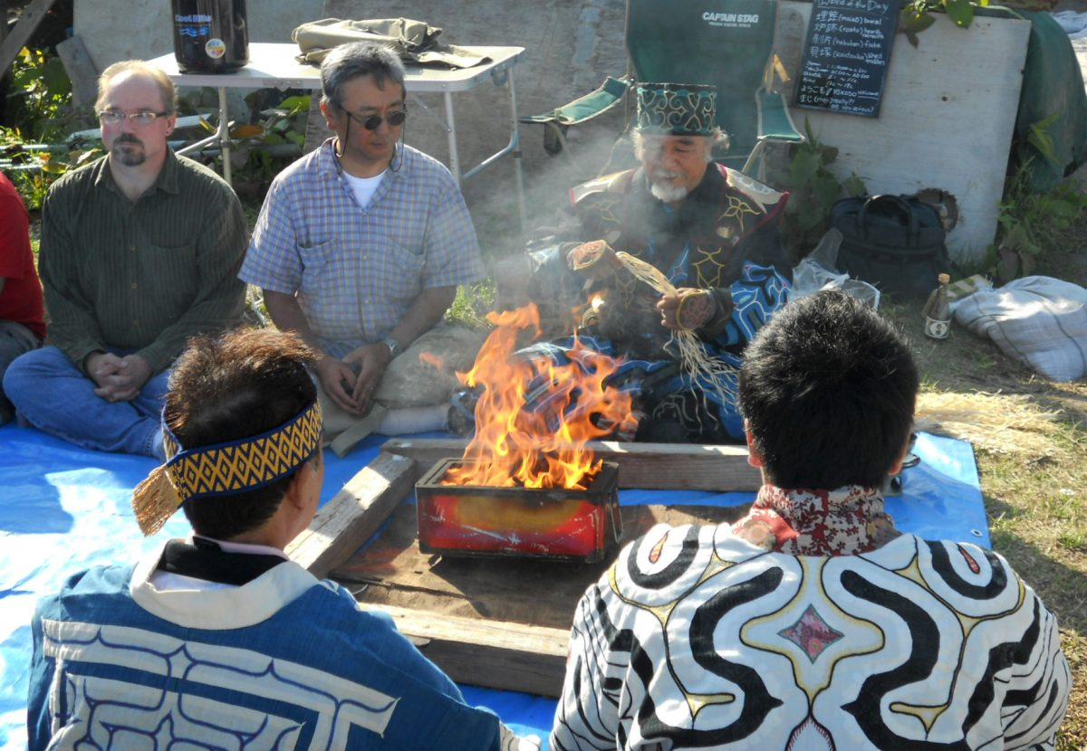 Ainu elders perform a ceremony at Hamanaka II. The archaeological dig initiated by Hirofumi Kato is the first to consult, involve, or ask permission of the Ainu. Photo by Mayumi Okada