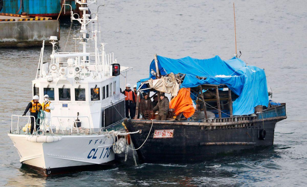 Japanese Coast Guard tows a North Korean fishing boat