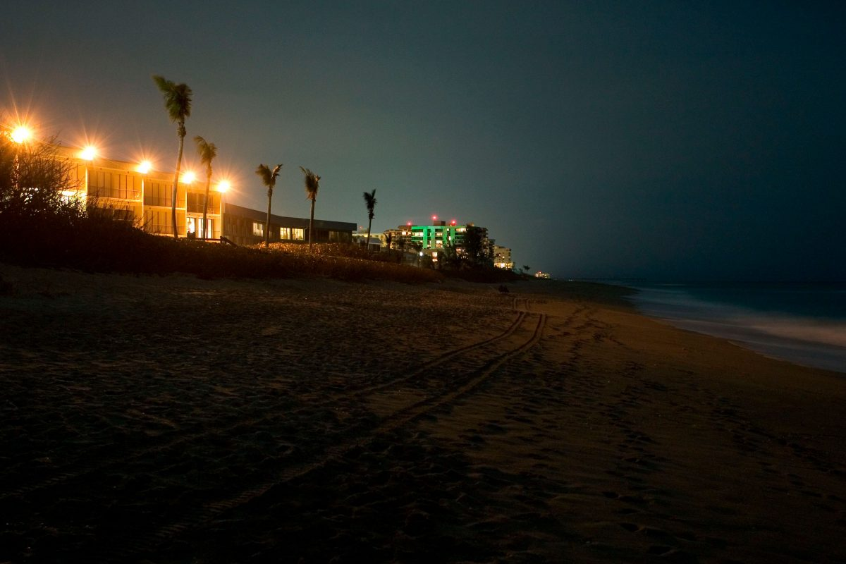 bright lights on building next to beach