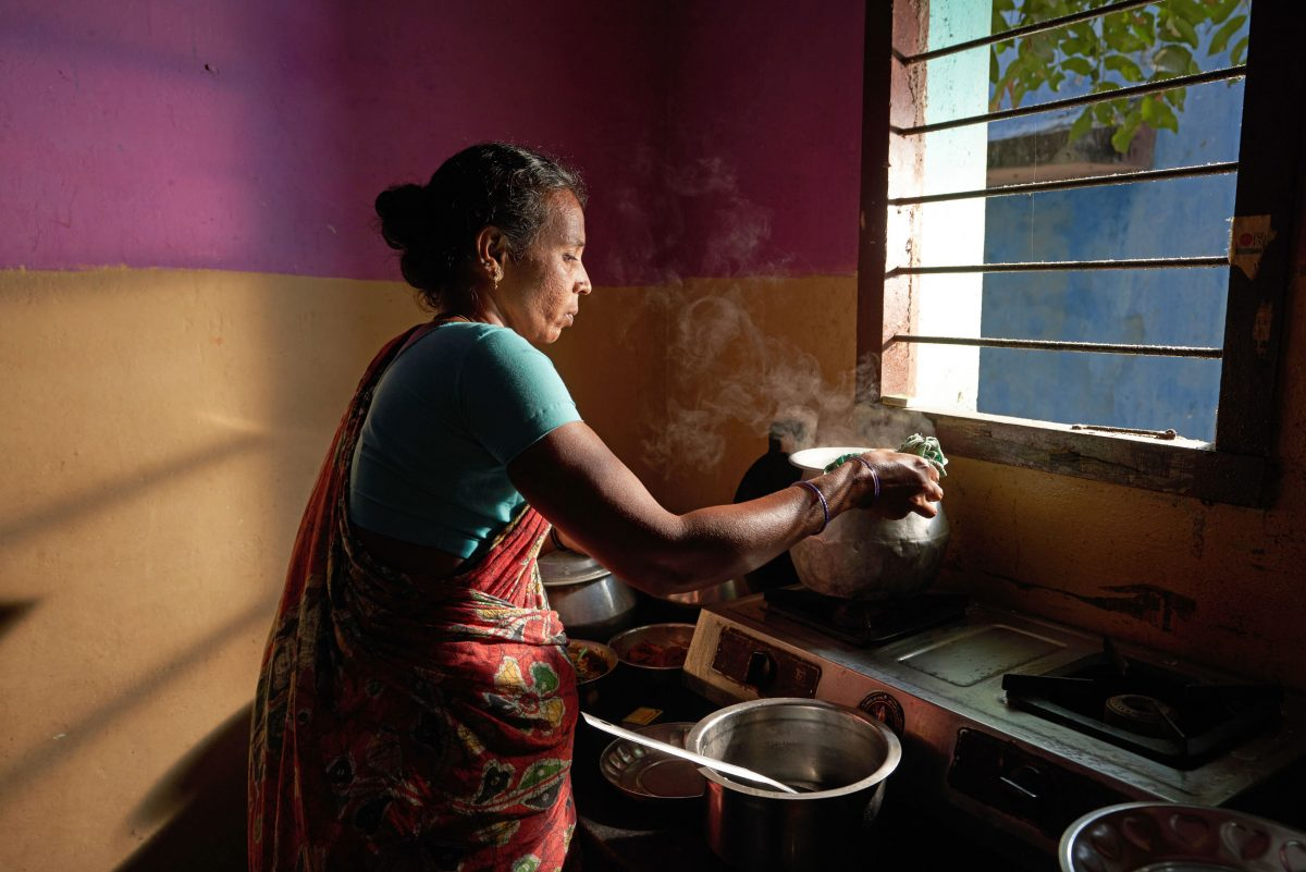 Thangam, the wife of a small-scale fisher, prepares a meal for Fishploration participants at her home.