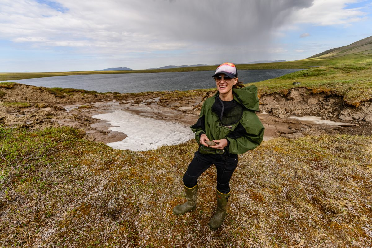 Rose Cory in front of the thermokarst of Wolverine Lake, near the Toolik Lake Research Natural Area on the North Slope of Alaska. Cory, an aquatic geochemist from the University of Michigan in Ann Arbor, is studying how much carbon will end up in the atmosphere as the permafrost thaws.
