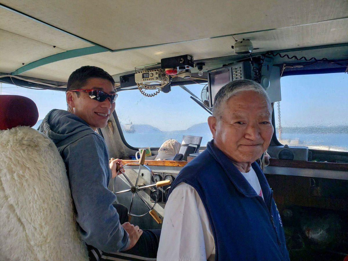 Dereck Hamada and Satoshi out at sea on the Magic Maker. Photo courtesy of the Hamada family