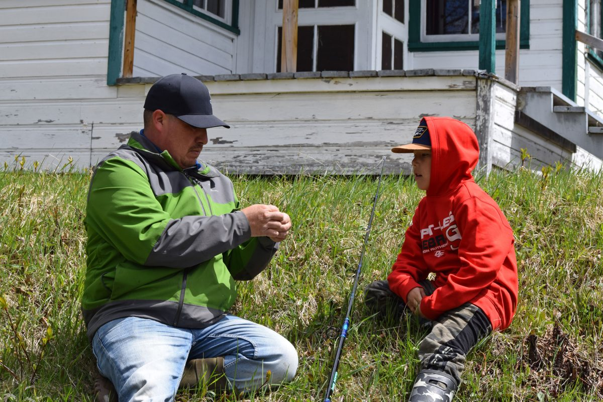 Rocky St-Onge and his son prepare to protest the private ownership of fishing grounds on the Moisie River by fishing from the restricted waters