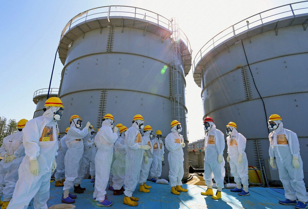 Prime Minister Shinzo Abe inspects the Fukushima power plant