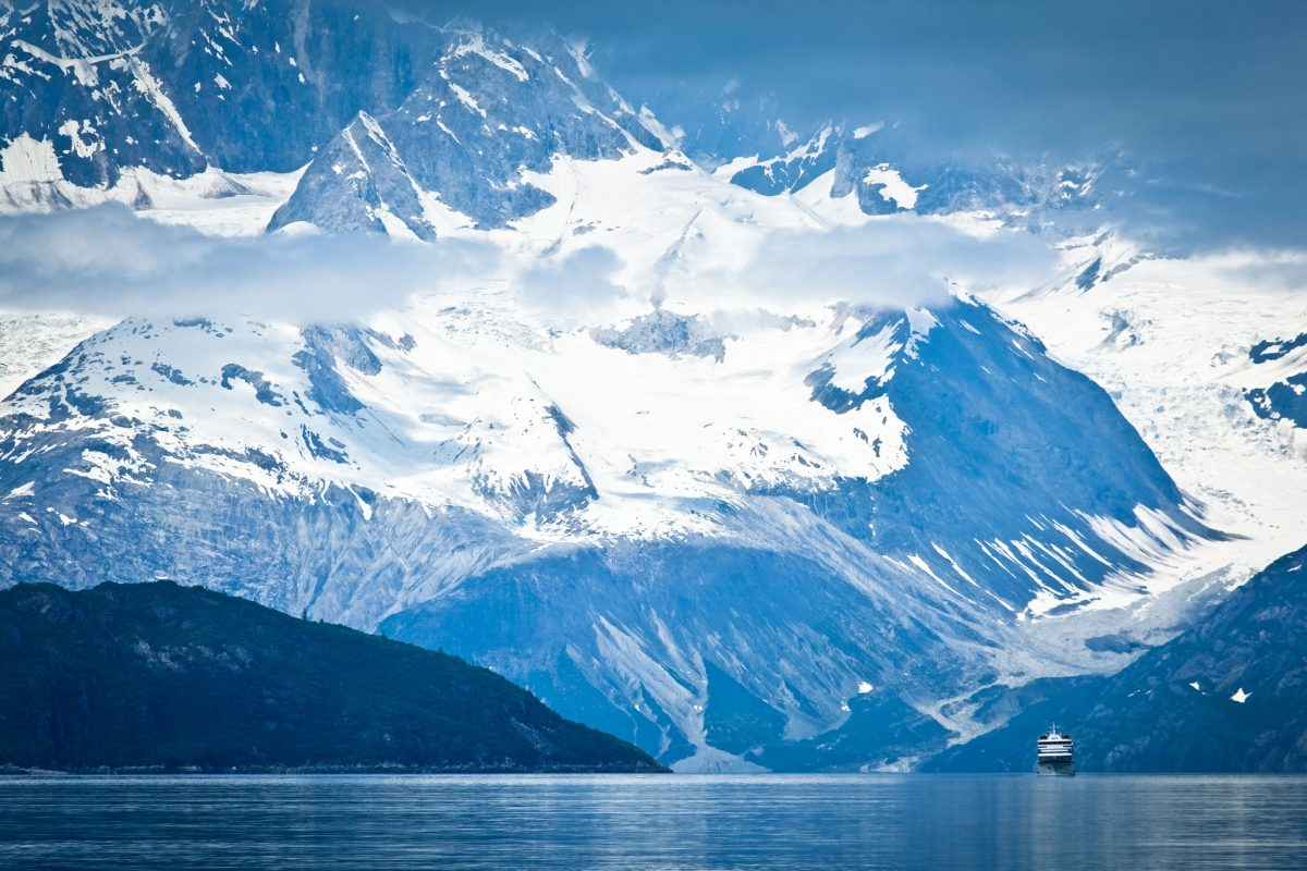 A small cruise ship sailing through Tarr Inlet with the Fairweather Range in the background, Glacier Bay National Park , Alaska