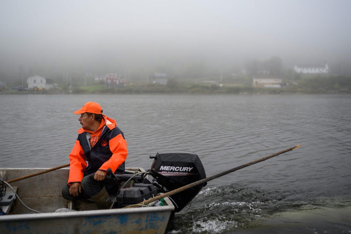 Joe Googoo sitting in a boat