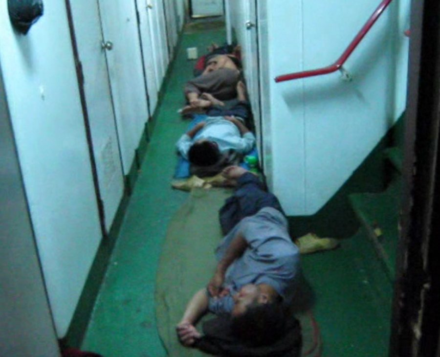 People sleeping in the hall on a fishing vessel