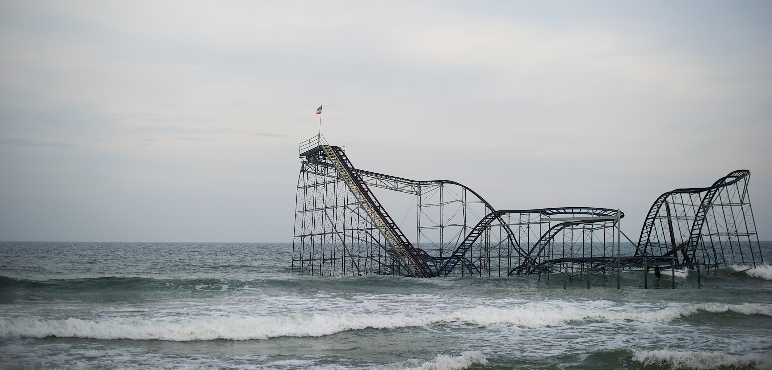 In 2012, Superstorm Sandy hit the New Jersey coastline, smashing homes, businesses, the boardwalk—and Seaside Heights' iconic roller coaster, an enduring symbol of the storm's ferocity. Photo by Mark Makela/Corbis