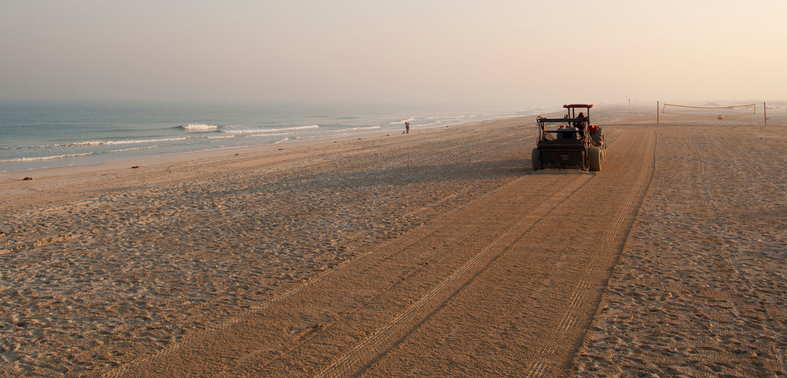 A Tractor Grooms Beach