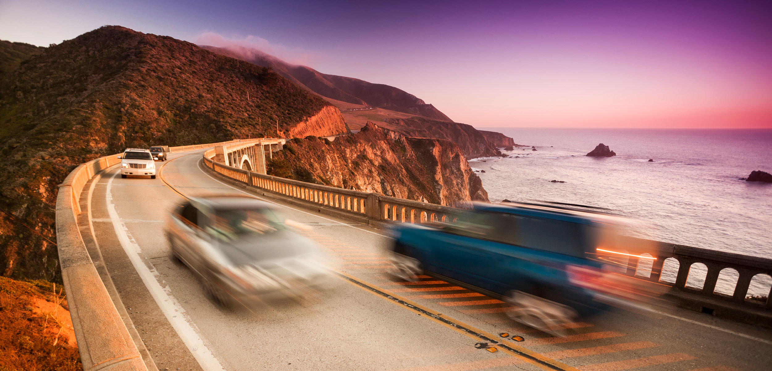 Car crossing the Bixby Bridge, Big Sur, California