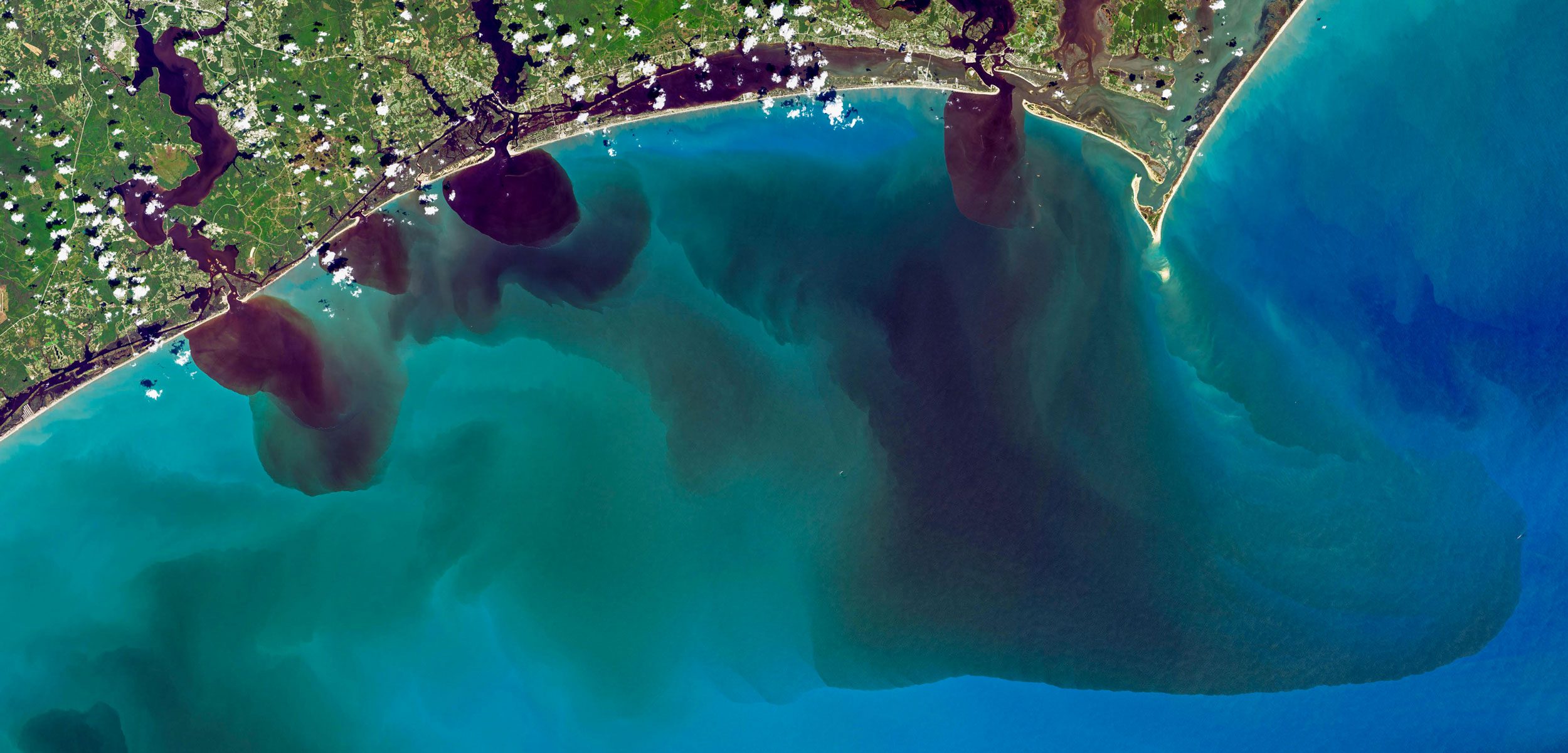 Aerial river and sea view showing dissolved organic matter seeping into the Trent River, North Carolina