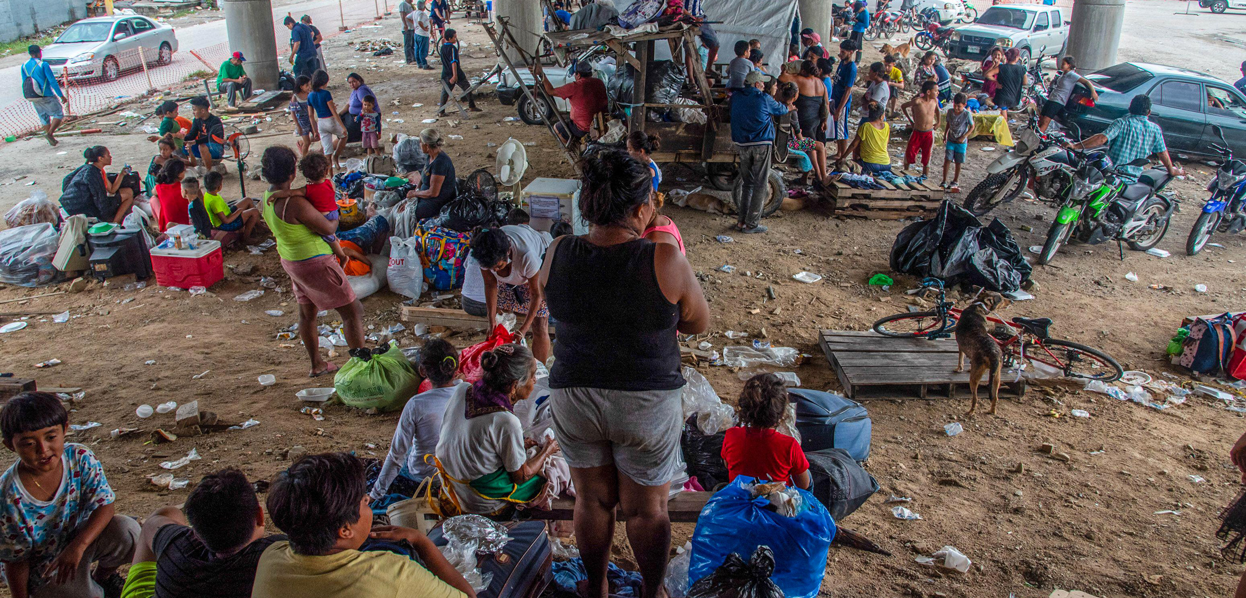 People in a makeshift camp underneath an underpass in Honduras after Hurricane Eta