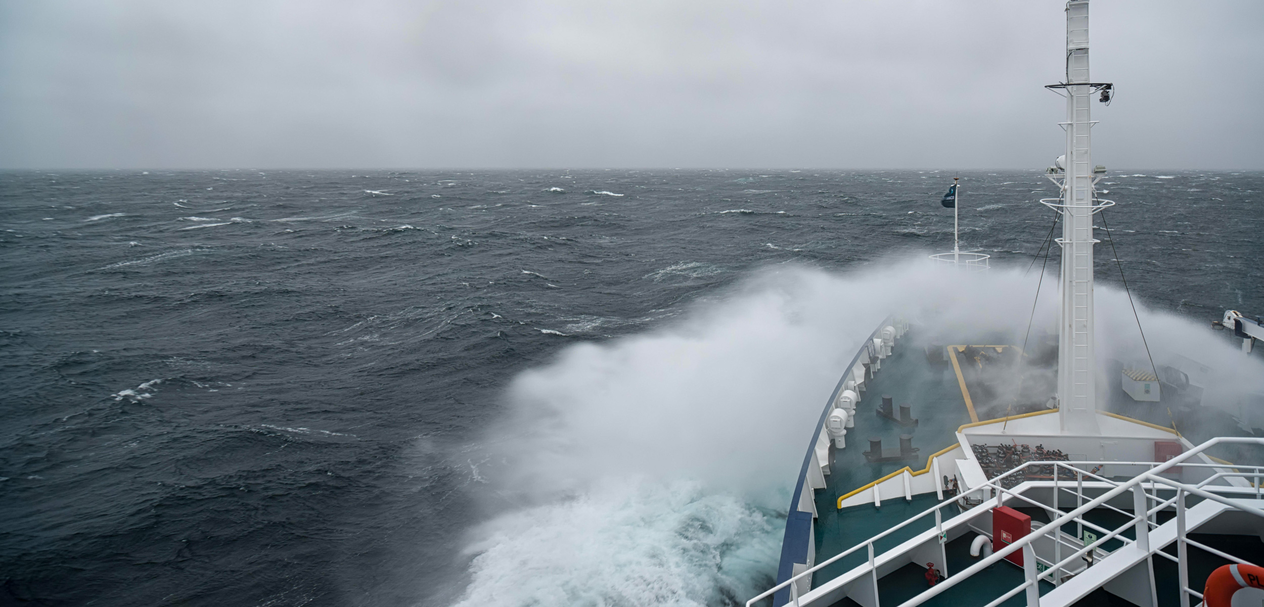 Ship cruising in storm and heavy seas