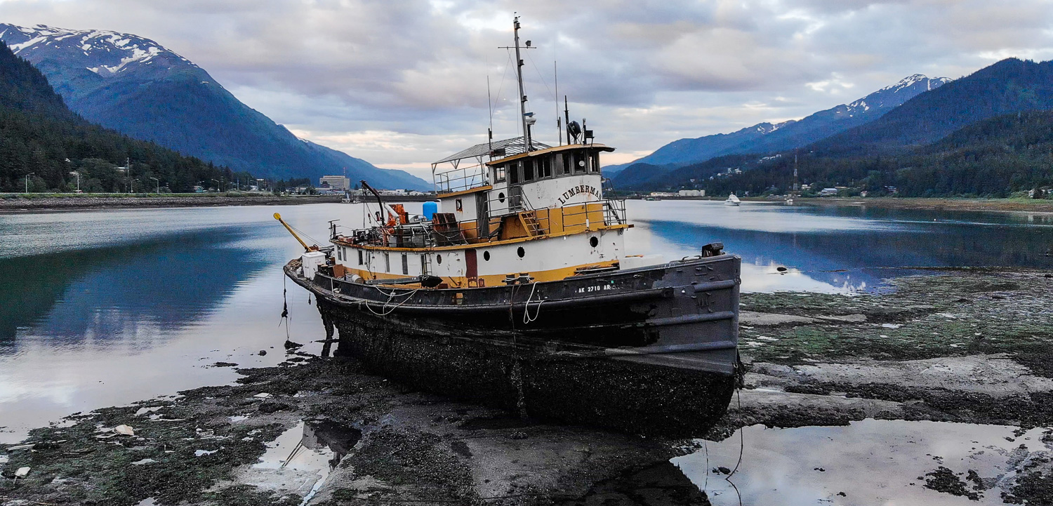 The Lumberman sits in Gastineau Channel at low tide in June 2018.