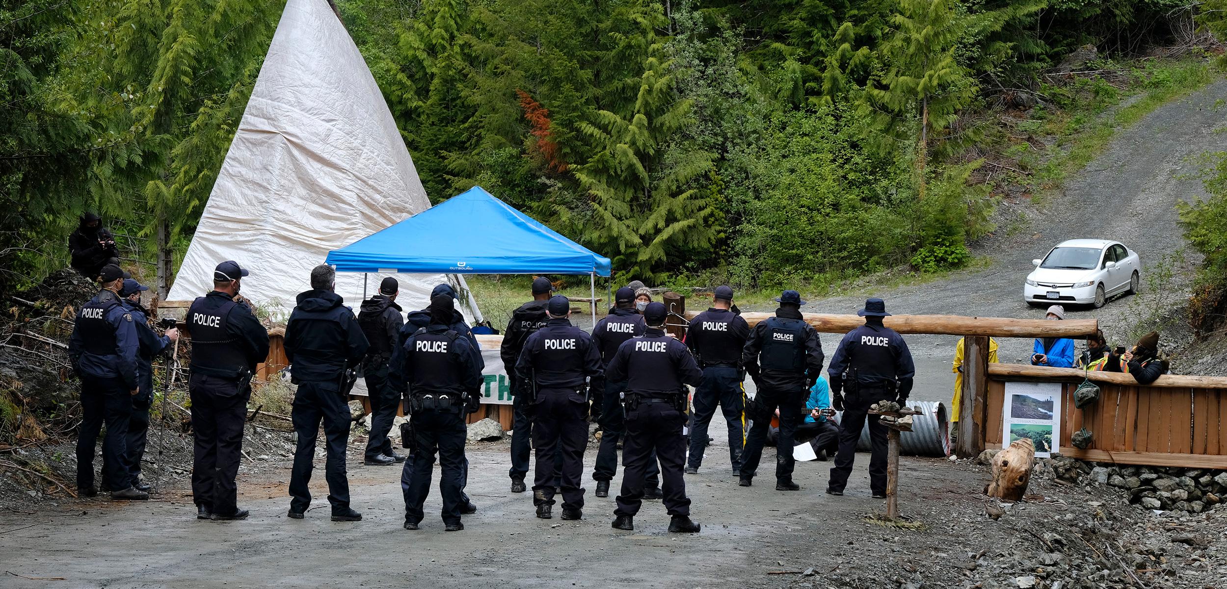 RCMP officers approach anti-logging blockade