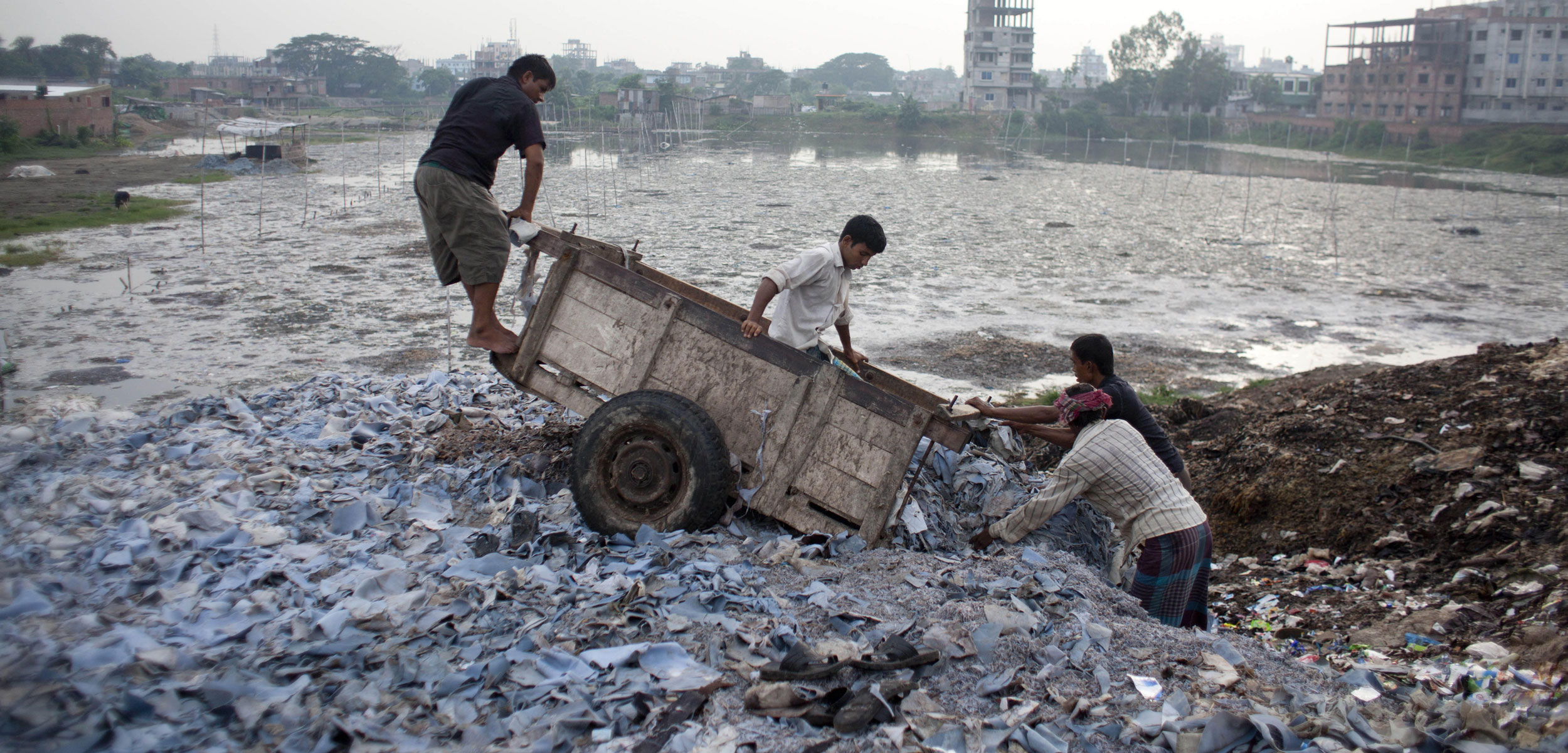 In Bangladesh, leather factories long dumped their toxic wastewater into the Buriganga River and discarded their leather scraps along its banks. Today, parts of the river are almost dead. Photo by Zuma Press, Inc./Alamy Stock Photo