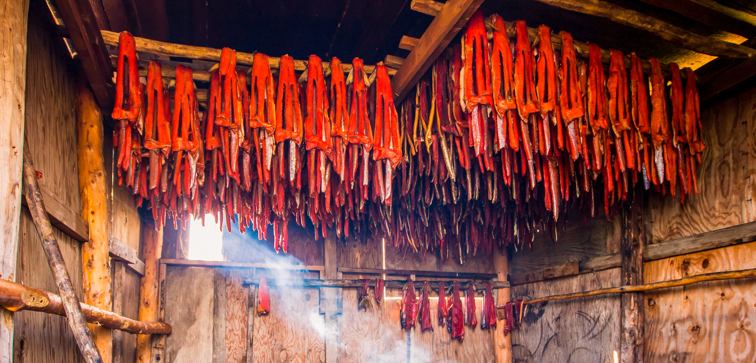 Strips Of Sockeye Salmon Hanging In A Large Smoker