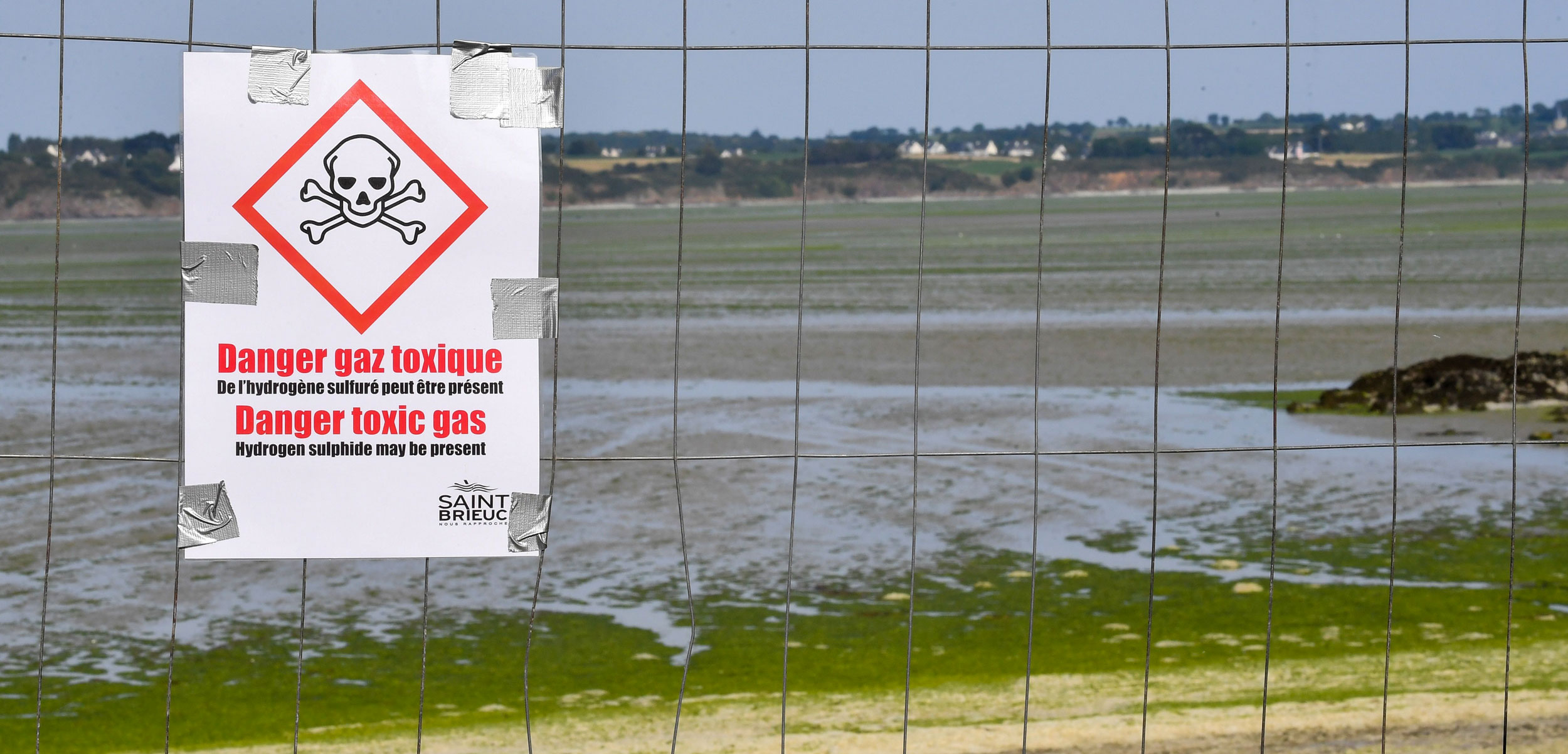 Danger Toxic Gas sign on beach in Brittany, France