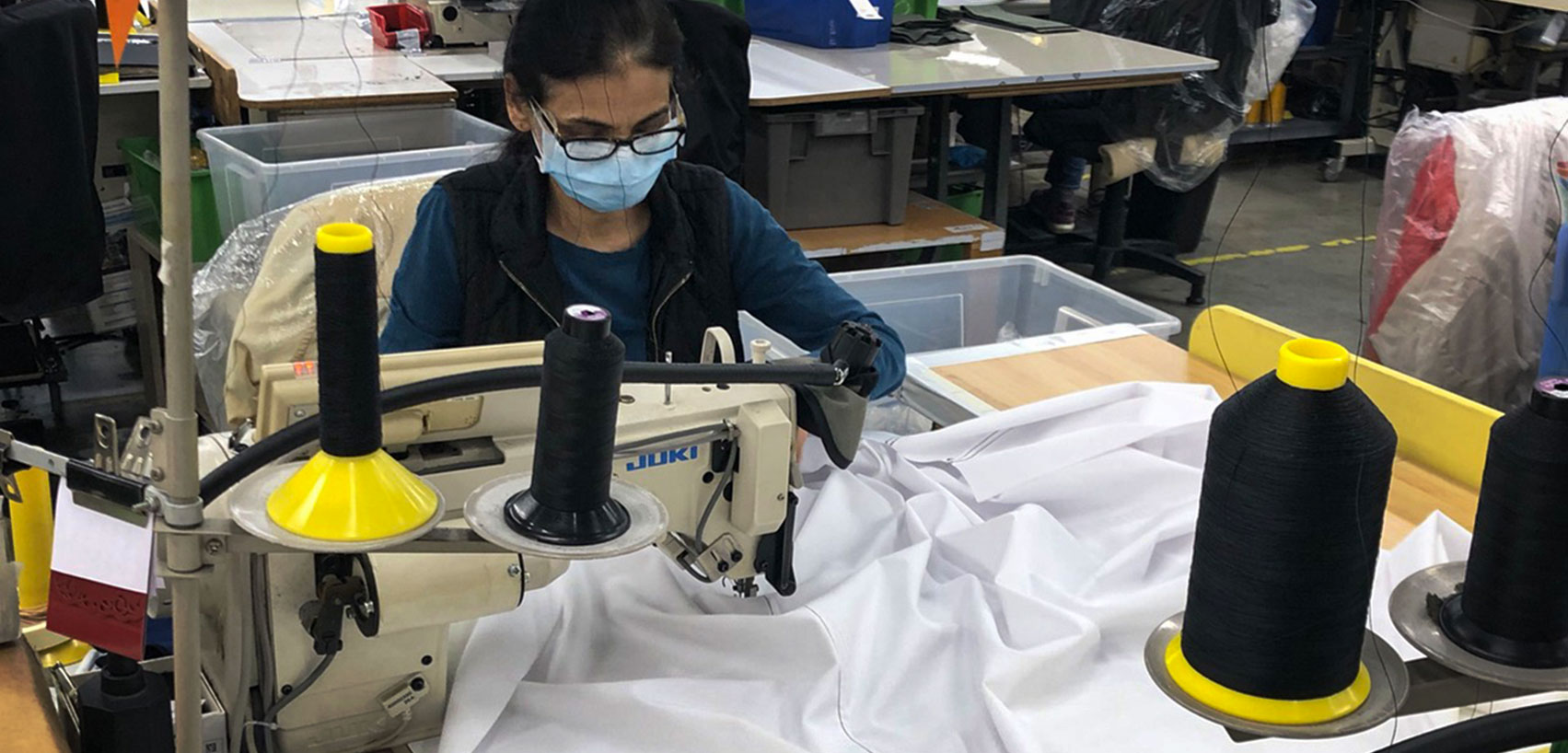person sewing a medical gown