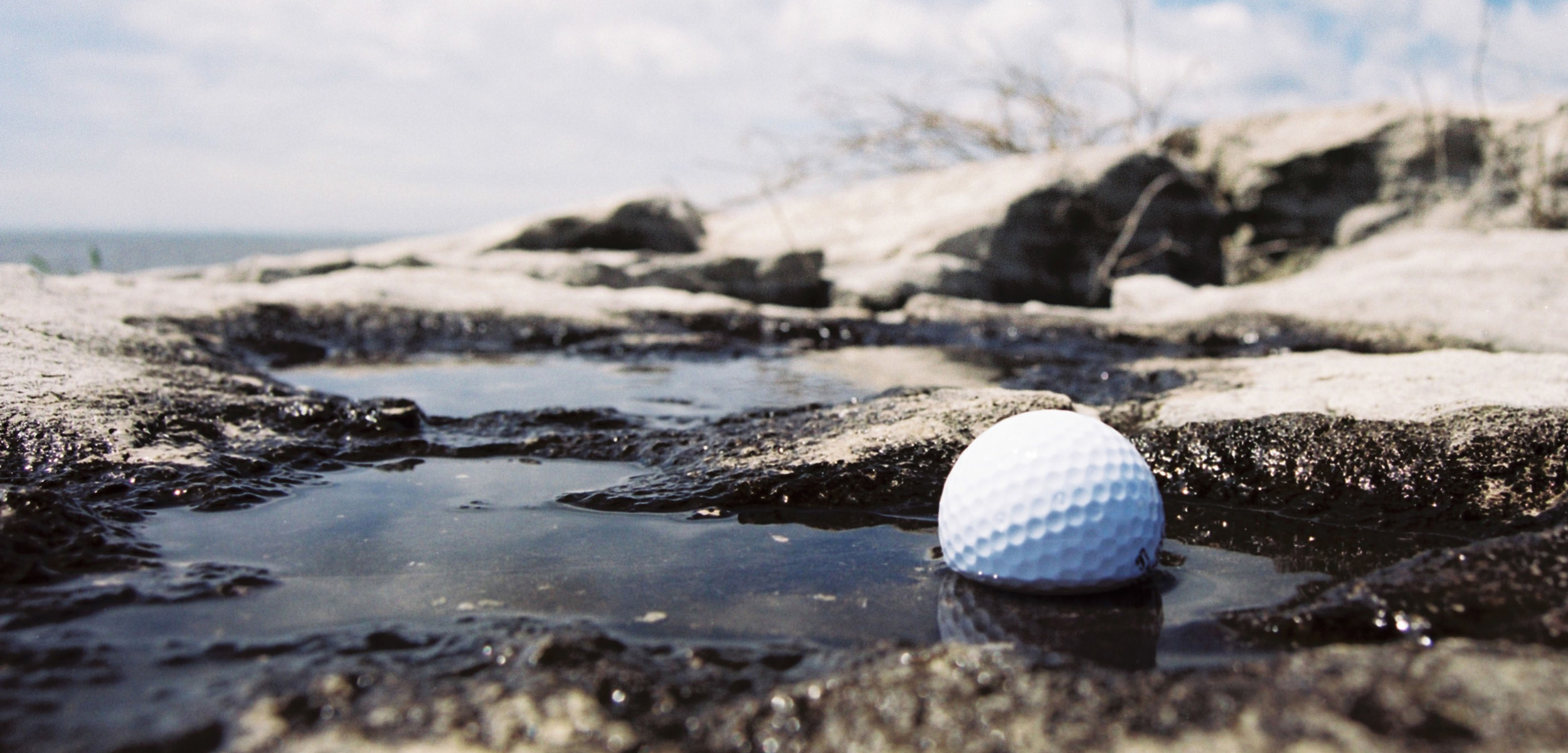 golf ball in water by the ocaen