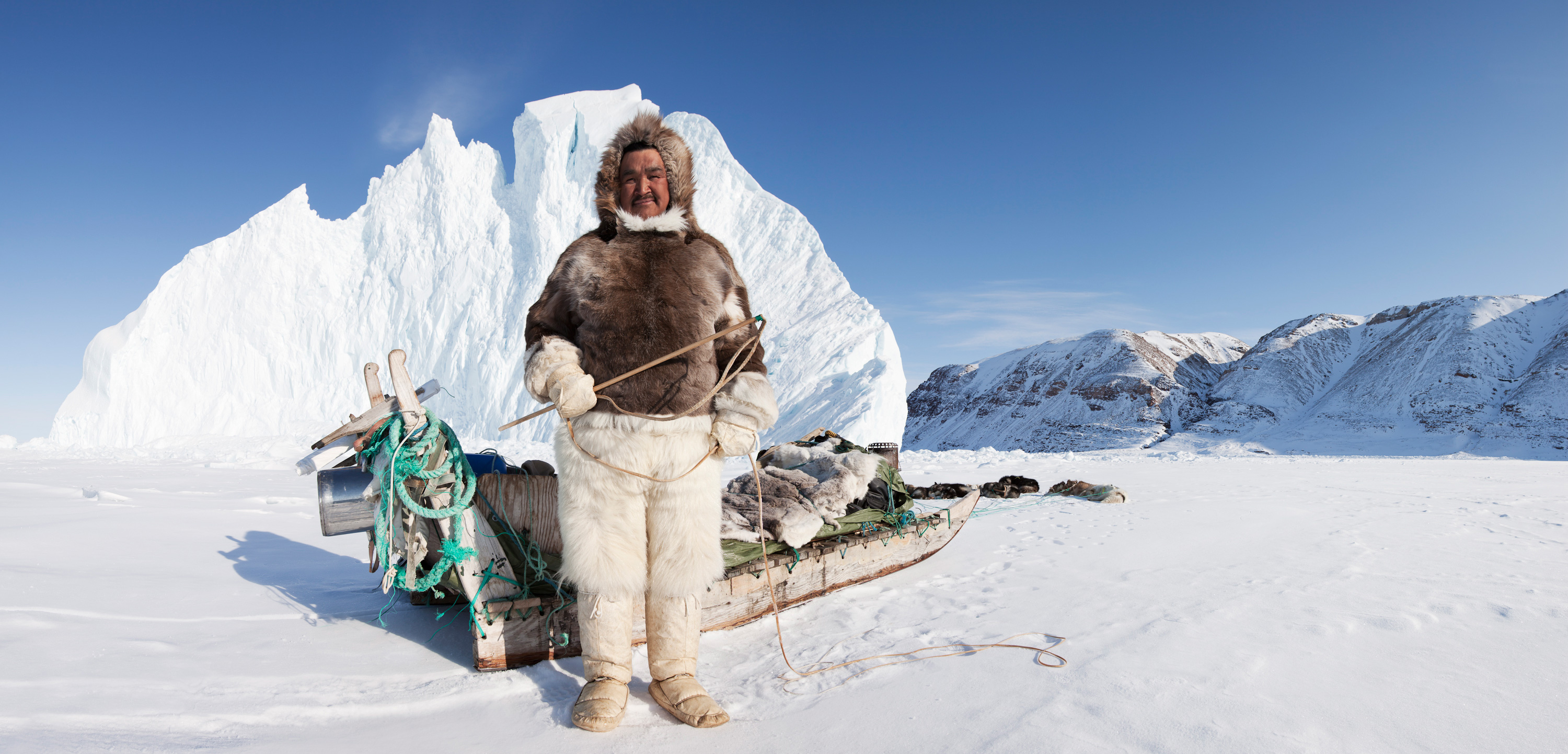 the seal hunters of greenland a photo essay hakai magazine  from reindeer that his grandmother stitched for him stands his sled and dog team also known by thomas his catholic qujaukitsoq is a hunter