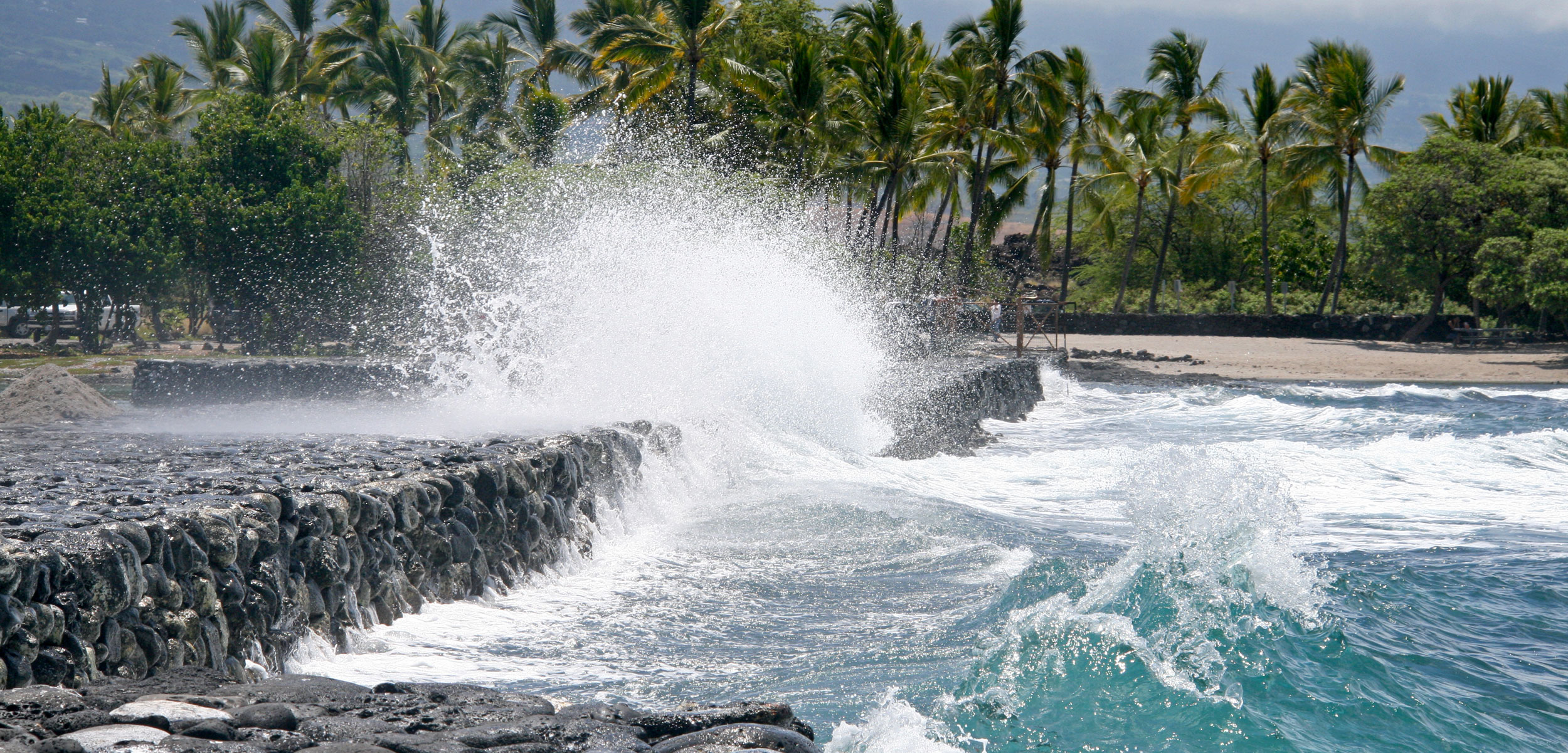 Pacific waves collide against the wall of the Kaloko fishpond on the Island of Hawai'i