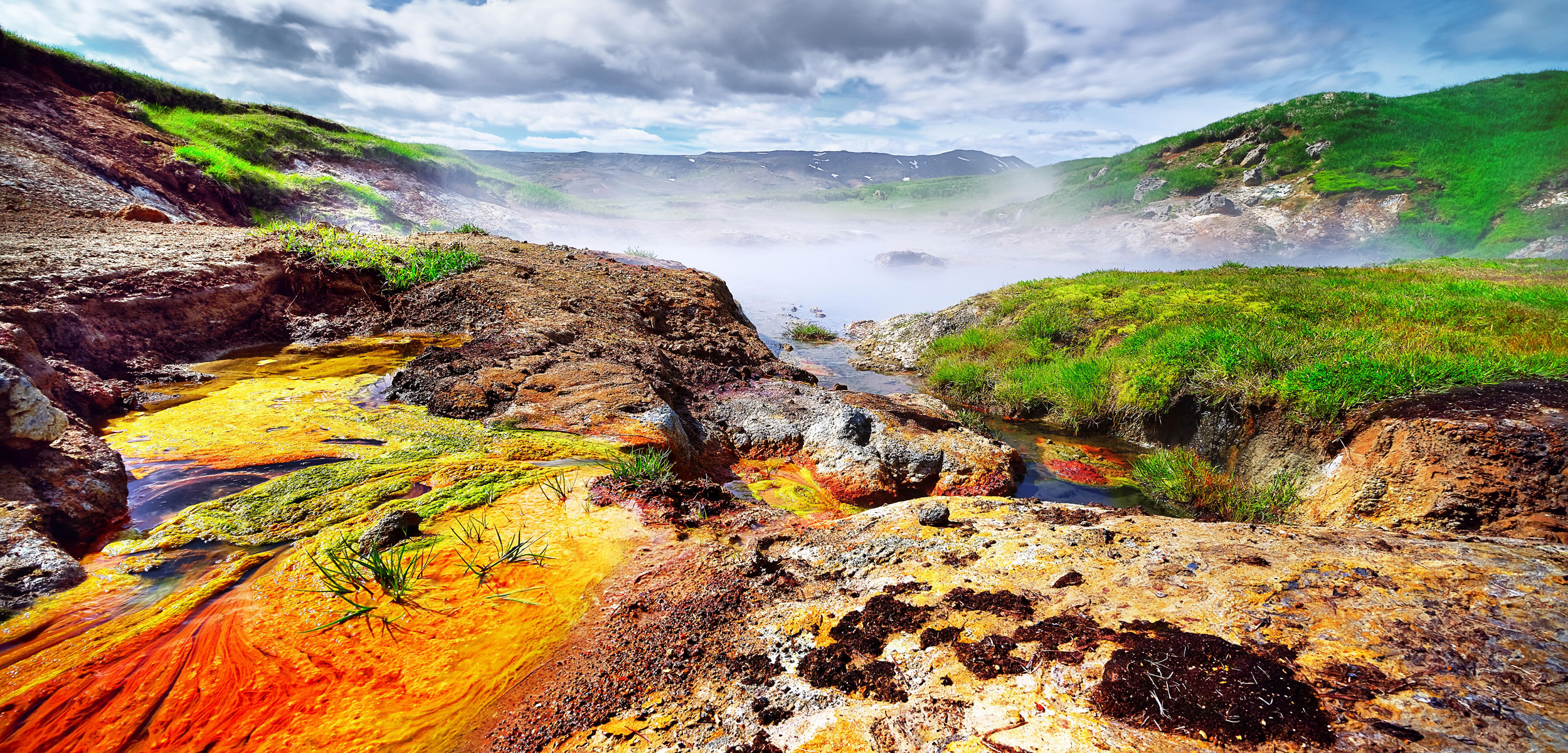 Geothermal area with very colorful deposits in Hengill, Iceland