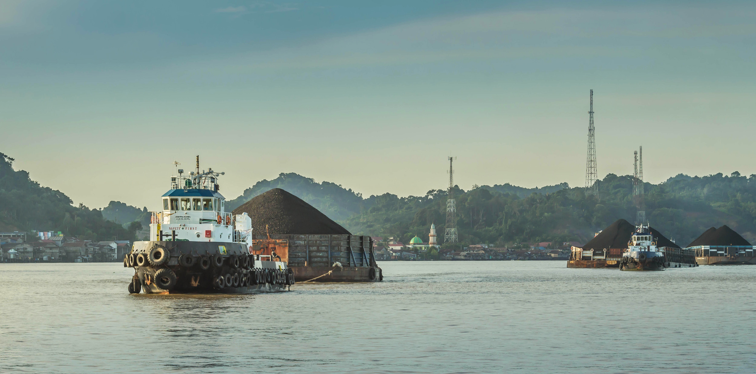 tugboat pulling coal in Indonesia