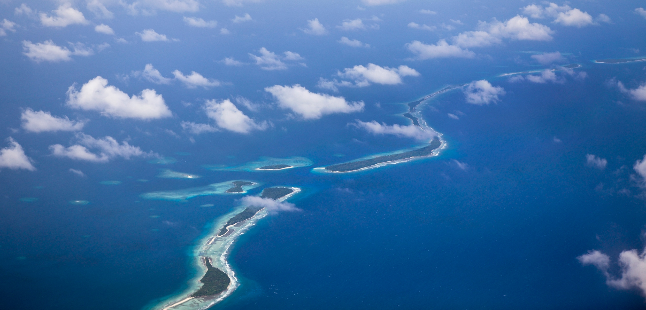 An aerial view of Kwajalein Atoll in the Marshall Islands. The independent nation is comprised of 1,200 islands in the Pacific Ocean with an average elevation of two meters above sea level. Photo by Visuals Unlimited/Corbis