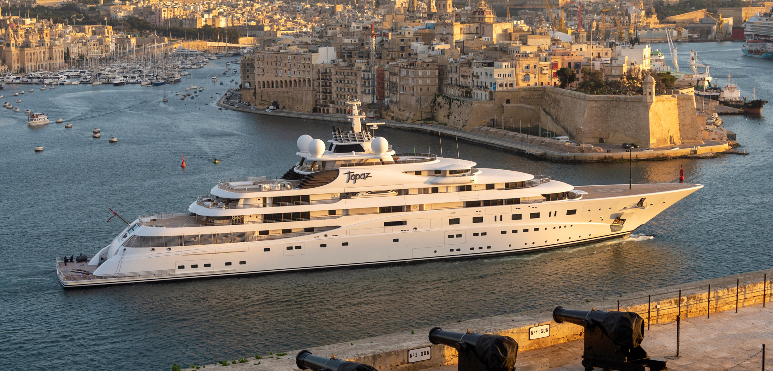 A privately owned megayacht enters the harbor at Valletta, Malta