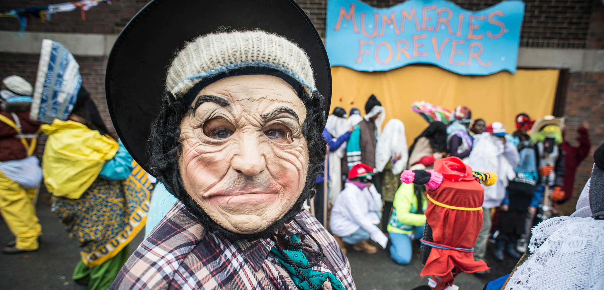 Mummers disguise every aspect of themselves—their faces, ears, hair, hands, gait, body shape, and, often, their gender. Photo courtesy of the Mummers Festival