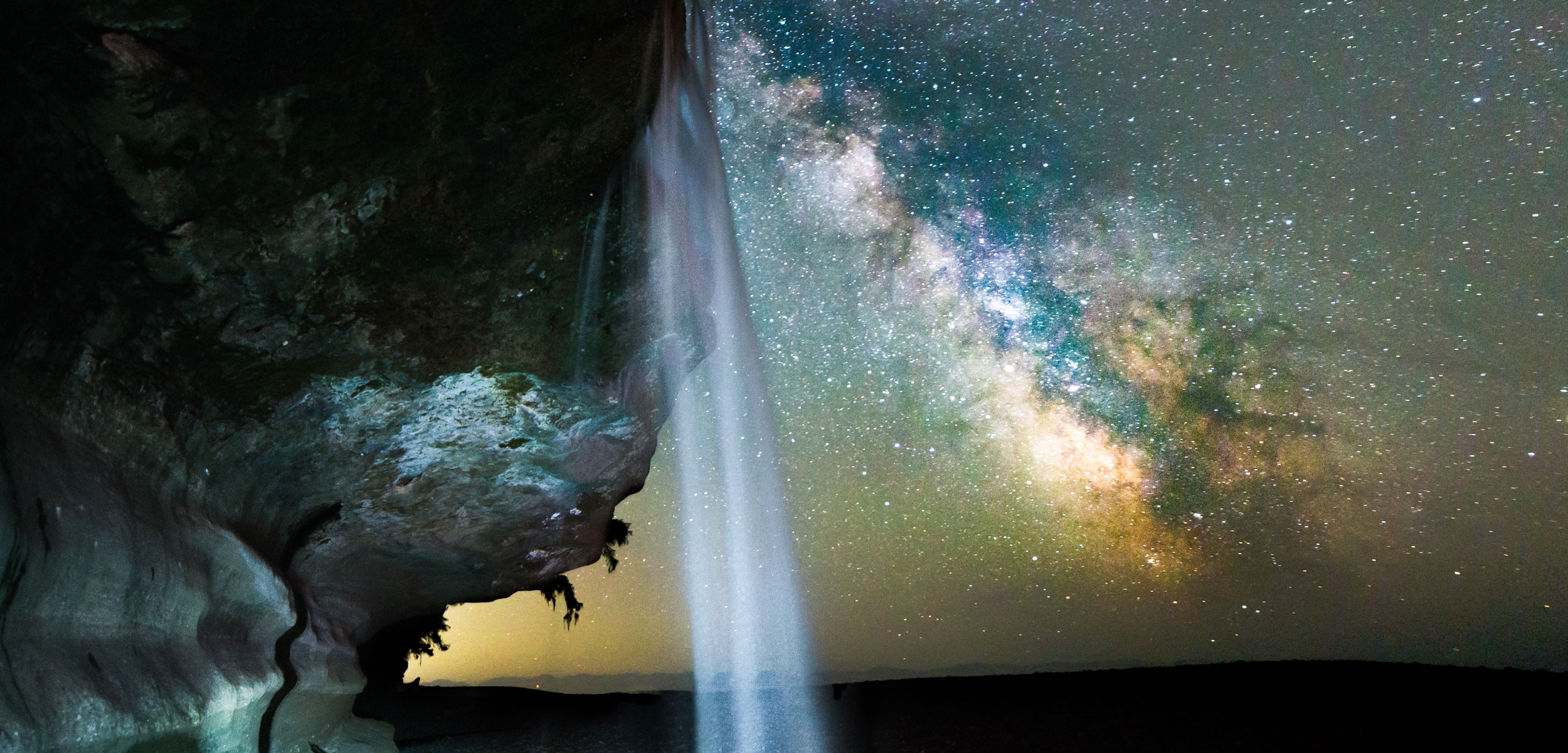milky way with waterfall